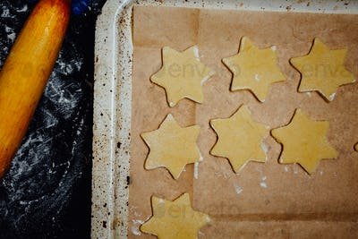 Star-shaped cookies on a baking pan