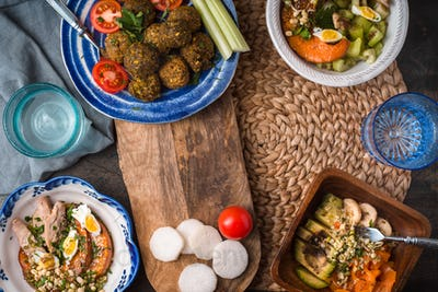Festive table with falafel, vegetable Salad and drinks
