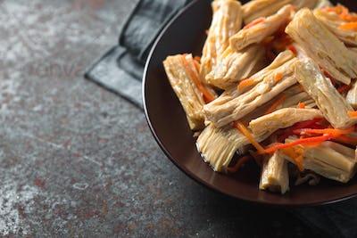 Appetizer Asparagus in Korean in a ceramic plate copy space