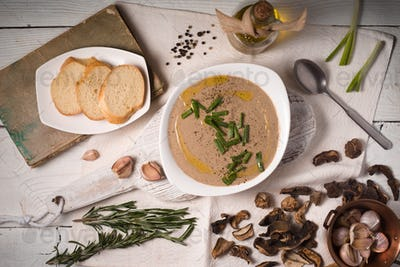 Mushroom cream soup on the  white wooden background top view
