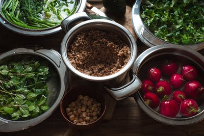 Ingredients for healthy salad with buckwheat ,vegetable and greens horizontal