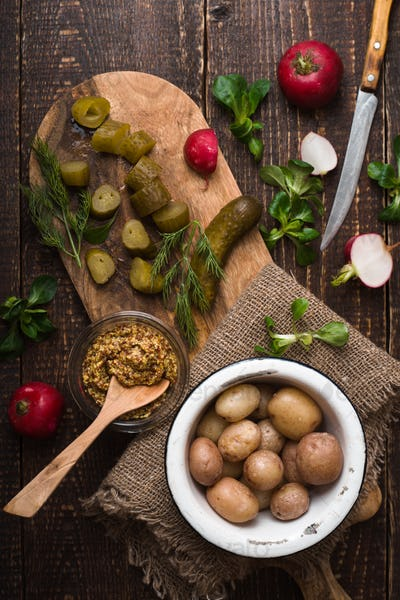 Ingredients for rustic vegetable salad on the wooden table