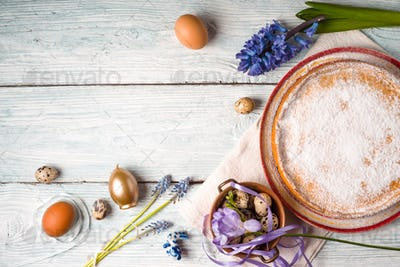 German Easter cake with decoration and flower on the white wooden table