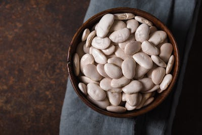 Large white beans in a wooden bowl