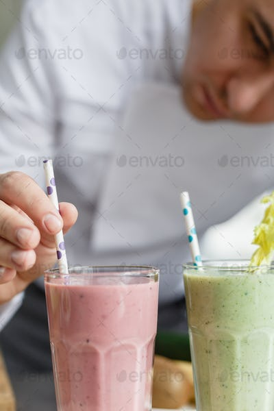 Male chef serving smoothies