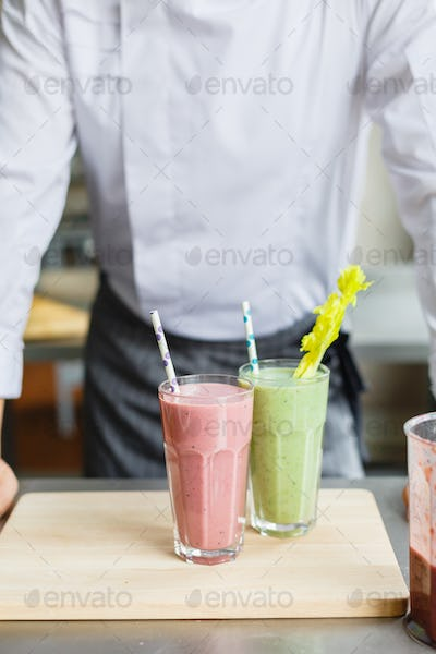 Crop shot of chef and smoothies
