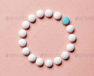 white pills on pink background
