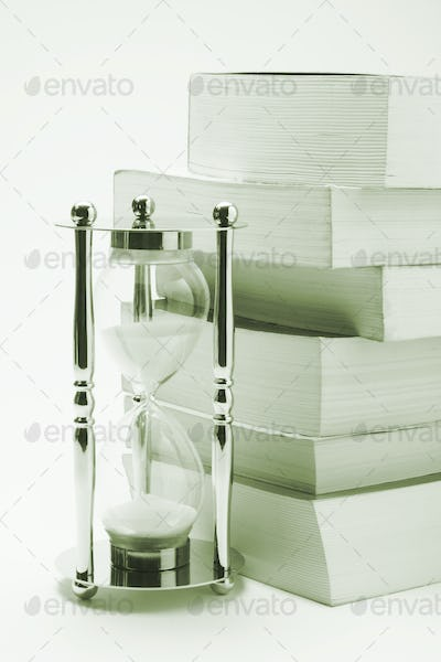 Hourglass and Books