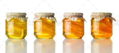 Different Colors of Honey in Jar on White Background