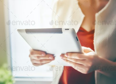 Woman working on the tablet