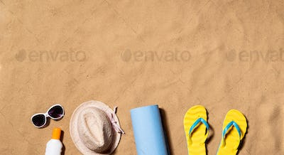 Summer vacation composition. Flip flops, hat and other stuff