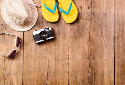 Summer vacation composition. Sunglasses, camera, hat, flip flops