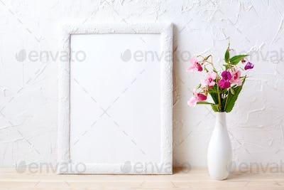 White frame mockup with pink flowers in elegant vase