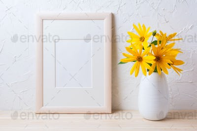 Wooden white frame mockup with yellow rosinweed flowers