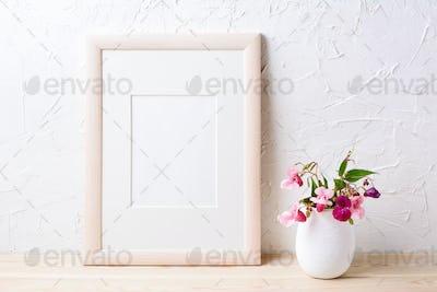 Wooden frame mockup with purple wildflowers in flowerpot