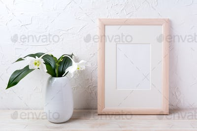 Wooden frame mockup with tender white lily in vase