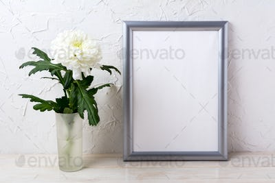 Silver frame mockup with white chrysanthemum in glass vase