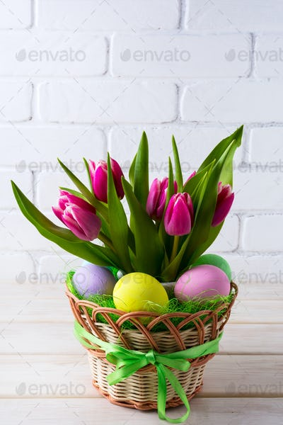 Easter table centerpiece with hand painted eggs in basket
