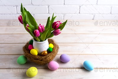 Easter table centerpiece with hand painted eggs in nest