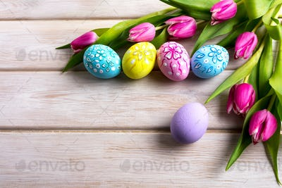 Easter hand painted floral decorated eggs with pink tulip