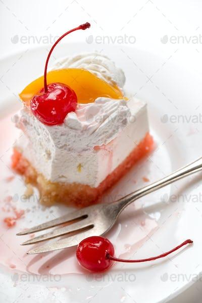 Fragment of bitten cake with dessert fork