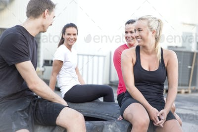 Happy workout team taking a break outdoor