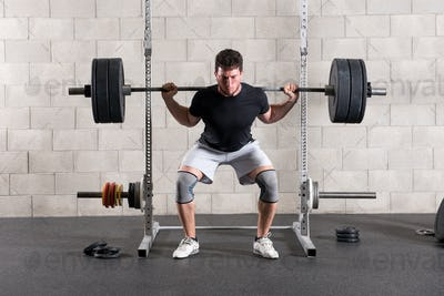 Man performing a crossfit back squat exercise