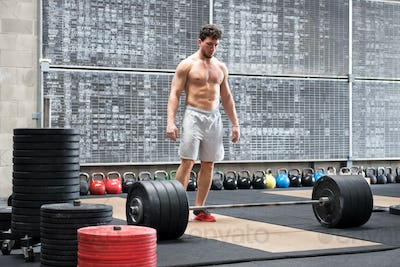 Athlete psyching himself up before lifting weights