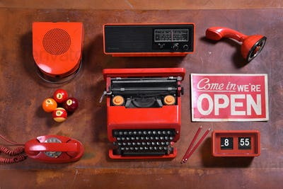 Collection of Red Vintage Objects on Wood Desk