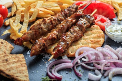 Grilled meat skewers on a pita bread