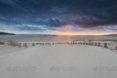 dramatic sunset and storm clouds over beach in Tarifa, Spain