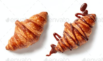 two croissants on white background
