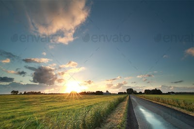 sunrise over countryside road