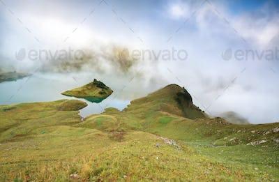 misty morning on alpine lake