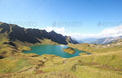 turquoise alpine lake in sunny day