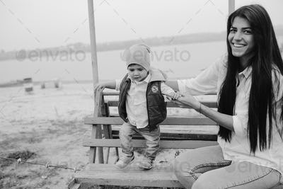 Mother and young son together on a bench