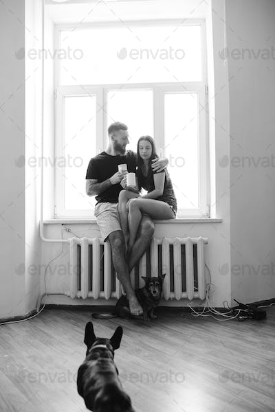 couple on the background of a window