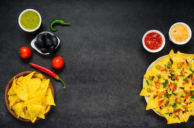 Nachos with Dip and Vegetables on Copy Space