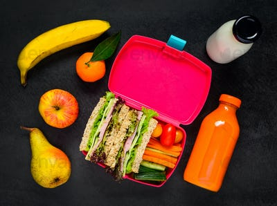 Lunch Box with Fruits, Drinks and Sandwich