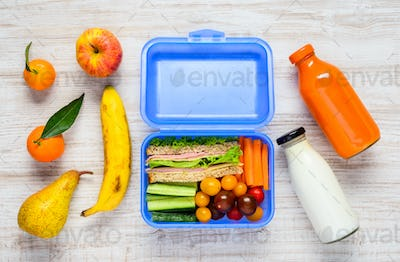 Blue Lunch Box with Fruits and Milk