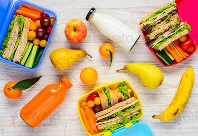 Lunch Boxes with Fruits and Drinks