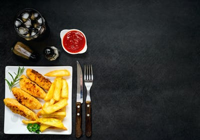Chicken Fingers with Fried Potatoes and Copy Space