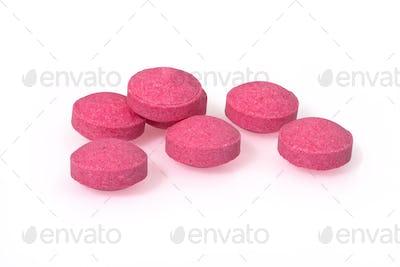 Pink pills closeup drug macro photography