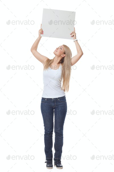 Beautiful blond girl holding blank poster