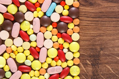 Colorful medical pills and capsules, health care concept
