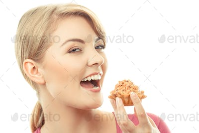 Vintage photo, Happy woman eating fresh cupcake, delicious dessert