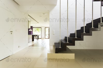 Staircase with brick wall