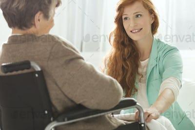 Nurse looking at elder woman