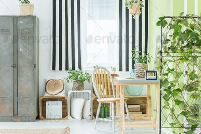 Room with striped window curtain