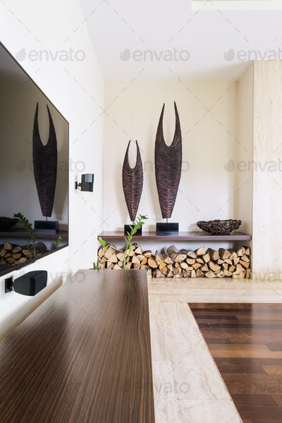 Modern fireplace wood storage inside house